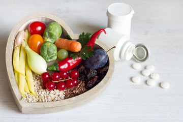 Healthy food in heart and medicaments diet concept