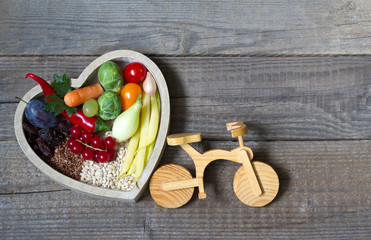 Healthy food in heart and bike diet sport lifestyle concept on vintage boards