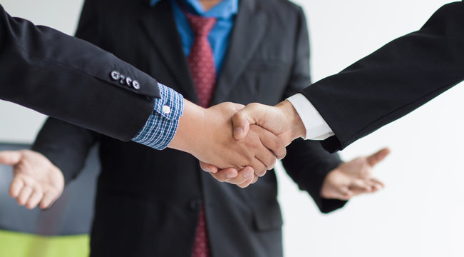 Business cooperation. Businessman shaking hands after business meetings are done well. Lawyers and legal mediation.