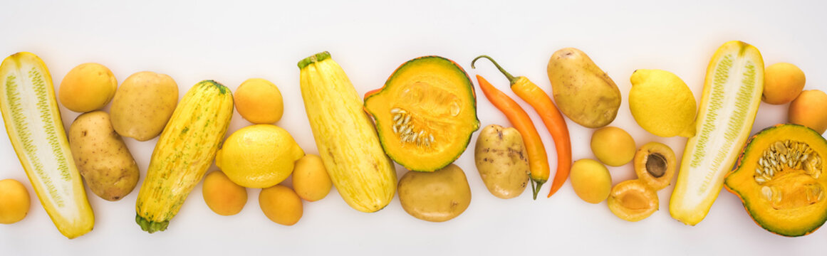 top view of yellow fruits and vegetables on white background with copy space, panoramic shot