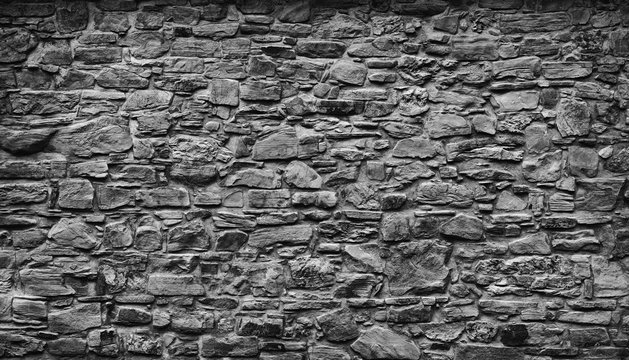Very old gray natural stone wall