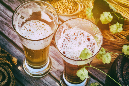 Fresh cold beer glasses in rustic setting