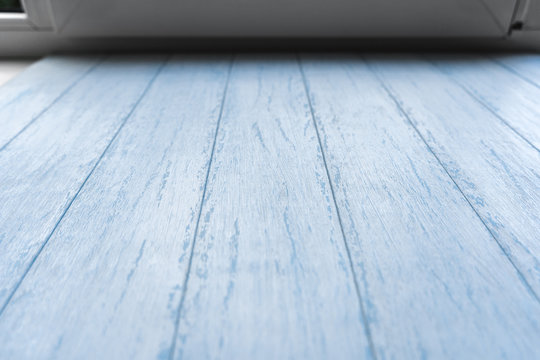Blank wooden surface of blue painted distressed boards