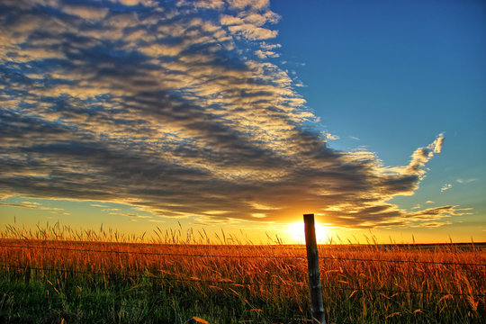 Ellis County, KS USA - A Spectacular Cloud Formation at Sunset over the Prairie Fields