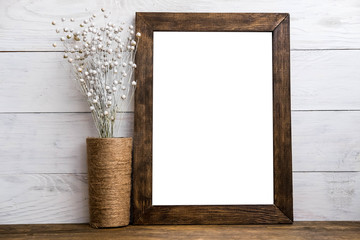 Mockup of blank wood frame poster on wall with decor