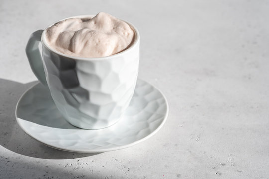 Hot chocolate, decorated with whipped cream and cinnamon