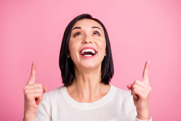 Closeup photo of pretty lady indicating fingers up empty space overjoyed with low prices wear white pullover isolated pink bright color background