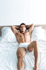sexy man in underwear lying on bed