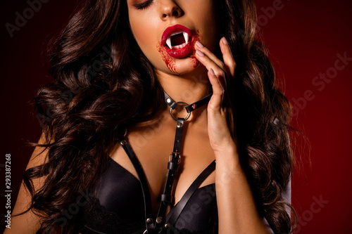 Cropped close-up view portrait of her she nice attractive glamorous bloody evil black brunette wavy-haired girl vamp demon touching lips isolated on dark red maroon burgundy marsala color background