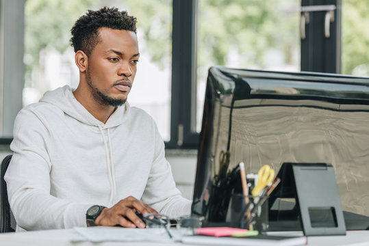 young african american programmer working on computer in office