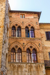 Old house facade with mullioned windows in italy