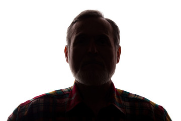 Portrait of a old man, front view - dark isolated silhouette