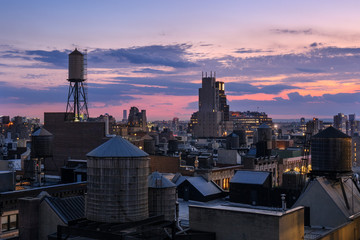 Chelsea rooftops at twilight with water towers. Manhattan, New York City