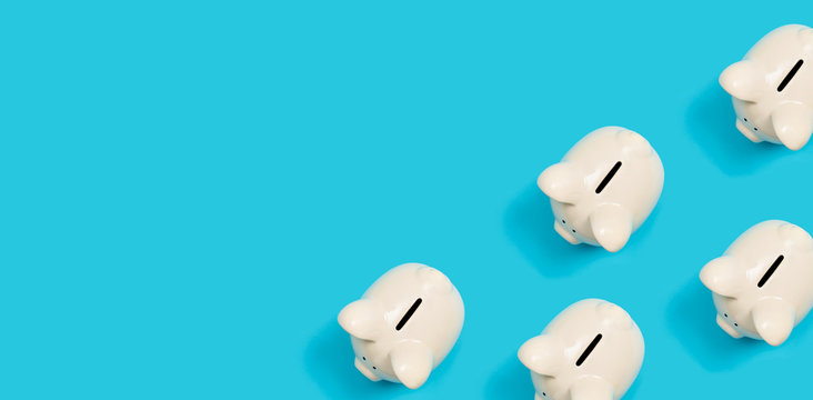 Many white piggy banks on a blue background