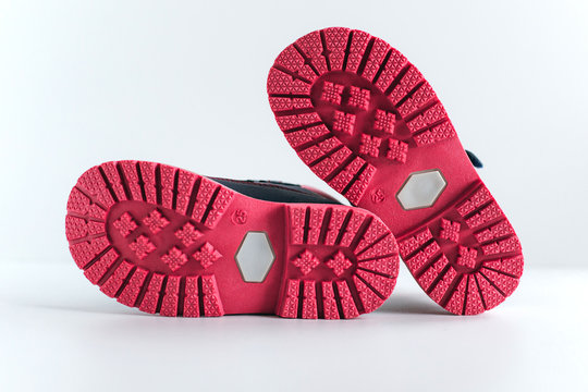 isolated pink sole of children's shoes on a white background