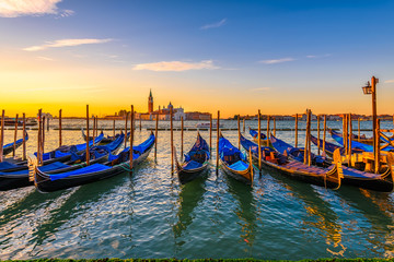 Fotobehang Gondolas Sunrise in San Marco square, Venice, Italy. Architecture and landmarks of Venice. Venice postcard with Venice gondolas