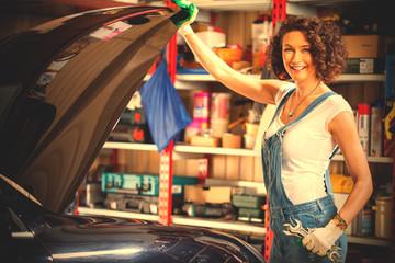smiling beautiful woman car mechanic