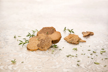Raw white truffle with fresh herbs.