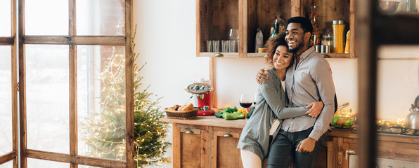 Young loving couple having good time at christmas morning