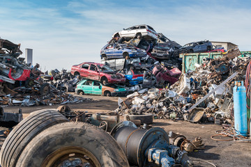 Old cars in landfill. Garbage pile in trash dump or landfill. Po