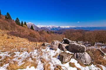 Mountain panorama in fall season with blue sky and clouds. Alps Italy. Friuli.