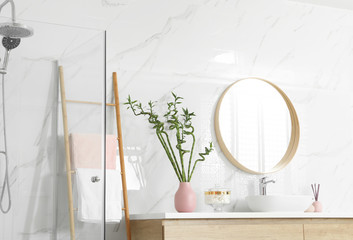 Stylish bathroom interior with beautiful green bamboo