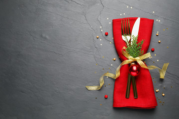 Fotobehang - Cutlery set on grey table, top view with space for text. Christmas celebration
