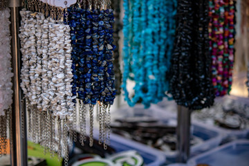 Close up of beads hanging on counter.