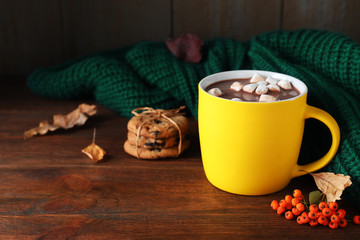 Canvas Prints Chocolate Cup of hot drink and knitted sweater on wooden table, space for text. Cozy autumn atmosphere