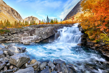 Aluminium Prints Blue sky Beautiful autumn landscape with yellow trees and waterfall