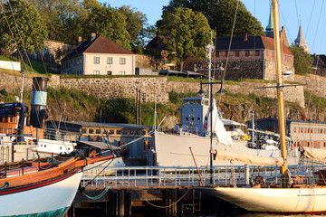 Boats in Oslo Harbor in front of Akershus Fortress on a summer afternoon