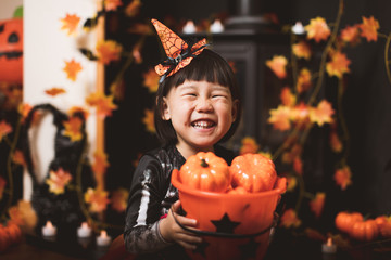 Toddler girl dressed up playing in Halloween party Wall mural