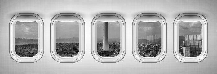 Airplane interior with window view of Kyoto City, Japan. Concept of travel and air transportation