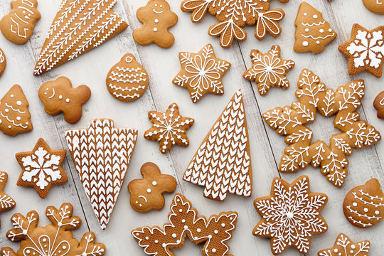 Christmas gingerbread cookies set on white planks