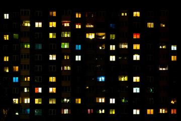 Flat night panorama of multicolor light in windows of multistory buildings. life in big city