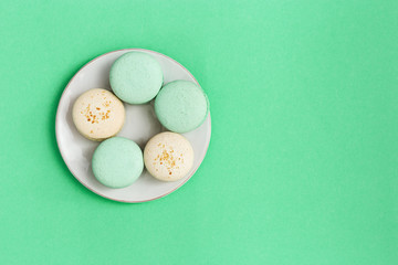Fotobehang Top view on plate with biscuits macaroon different colors and taste. Mint and almond cookies. Fashion Delicious dessert.