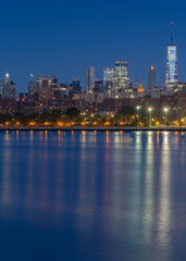 Downtown Manhattan view from East River at blue hour with long exposure