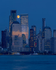 New York skyline with full moon at blue hour from Hudson river with