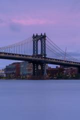 Manhattan Bridge from East rivet at sunset with long exposure