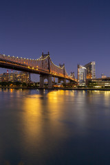 View on Queensboro Bridge and Roosevelt island architecture at night with long exposure