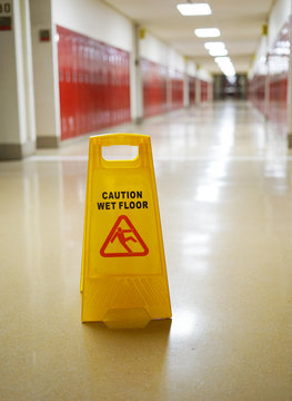 slippery caution sign in the school hall