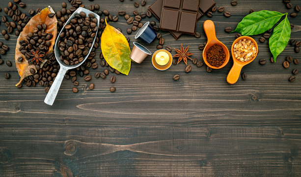 Coffee beans ,coffee capsule and coffee powder on dark wooden background. Top view with copy space.