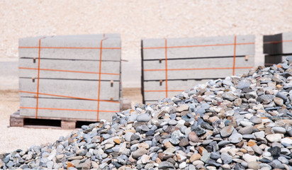 large heap of granite pebbles at construction site