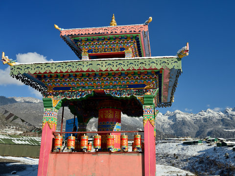 Tawang, Arunachal Pradesh, India - The colour prayer mills on the snowy hillside which surrounding Tawang