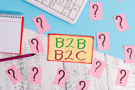 Text sign showing B2B B2C. Business photo text two types for sending emails to other showing Outlook accounts Writing tools, computer stuff and math book sheet on top of wooden table