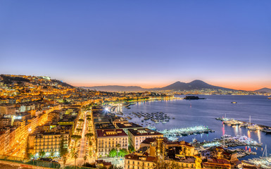 Deurstickers Napels Naples in Italy with Mount Vesuvius before sunrise