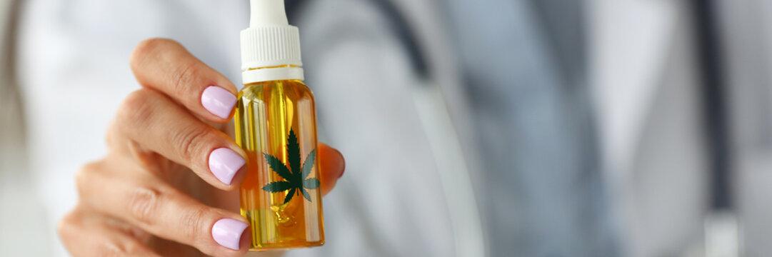 Doctor in office prescribing marijuana extract