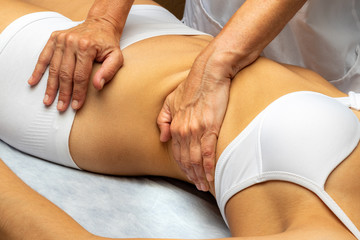 Physiotherapist manipulating thorax on woman.