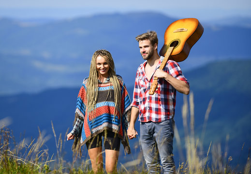Deep in love. couple in love spend free time together. western camping. hiking. happy friends with guitar. friendship. campfire songs. country music. romantic date. men play guitar for girl