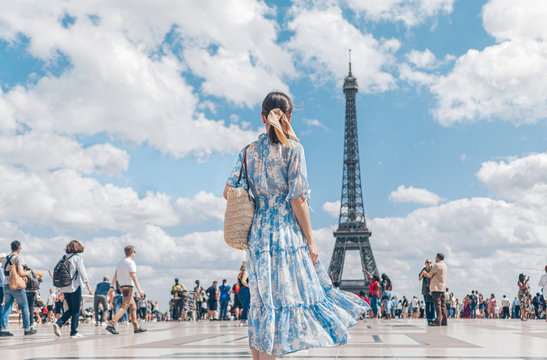 Attractive girl in a dress in Paris